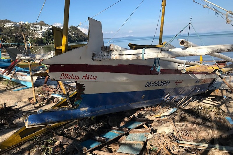 This photo shows a boat damaged by Typhoon Phanfone, on Bulabog beach on the Philippine island of Boracay on December 26, 2019. -AFP