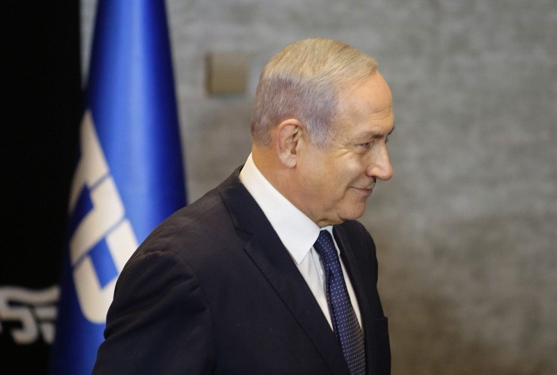 Israeli Prime Minister Benjamin Netanyahu leaves after delivering a statement regarding his intention to file a request to the Knesset for immunity from prosecution, in Jerusalem on Wednesday. — AFP