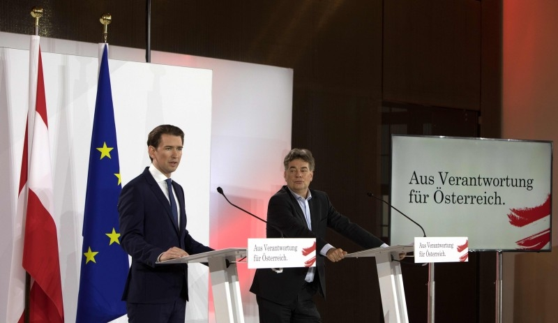 Head of the Austria People's Party (OevP) Sebastian Kurz (L) and Head of the Austrian Green Party Werner Kogler address a press conference to present the newly-formed coalition government's program on Thursday in Vienna. — AFP