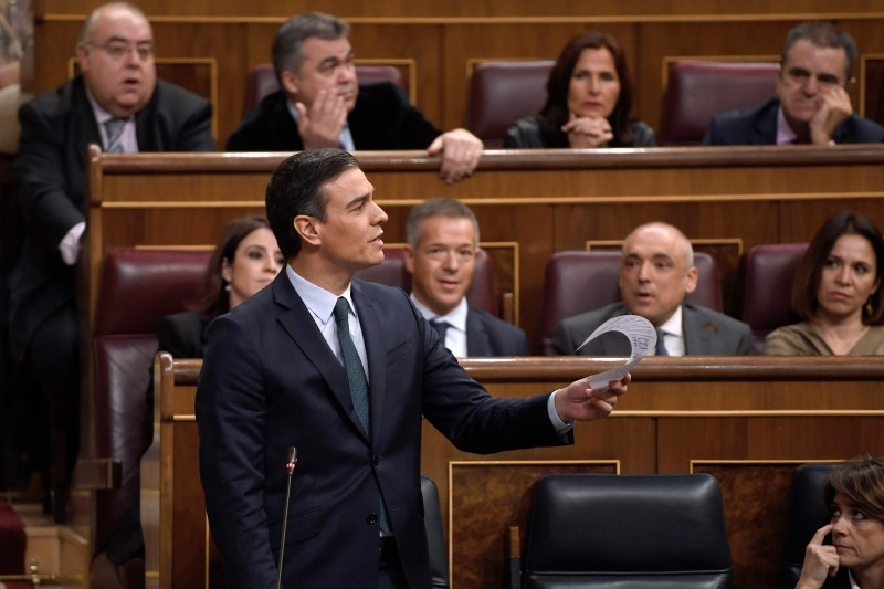 Spanish caretaker prime minister, socialist Pedro Sanchez, speaks from his seat during the second day of a parliamentary investiture debate to vote for a premier at the Spanish Congress (Las Cortes) in Madrid on Sunday. -AFP
