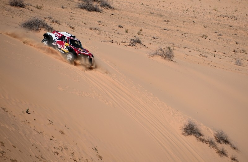 Mini's Spanish drivers Carlos Sainz of Spain and co-driver Lucas Cruz of Spain compete during the Stage 5 of the Dakar 2020 between AlUla and Ha'il on Thursday. — AFP