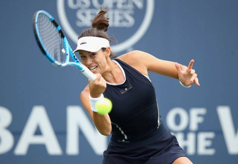 Two-time Grand Slam champion Garbine Muguruza crashed out of the Shenzhen Open semifinals on Friday with a straight-sets loss to Ekaterina Alexandrova.