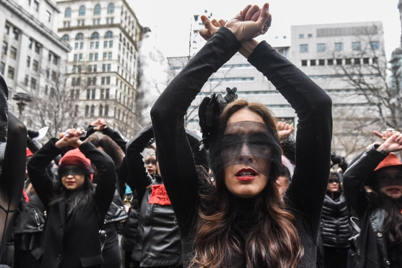 Women inspired by the Chilean feminist group called Las Tesis perform