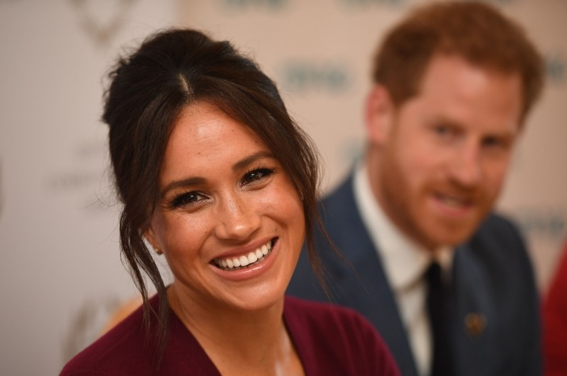 Britain's Prince Harry, Duke of Sussex, right, and Meghan, Duchess of Sussex attend a round-table discussion on gender equality with The Queen's Commonwealth Trust (QCT) and One Young World at Windsor Castle in Windsor in this Oct. 25, 2019 file photo. — AFP