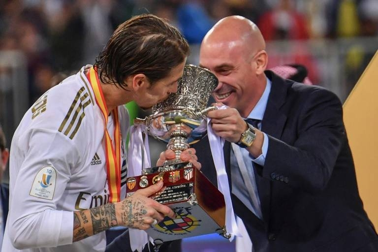 Real Madrid beat city rivals Atletico Madrid in a penalty shoot-out in Saudi Arabia to win their 11th Spanish Super Cup.
