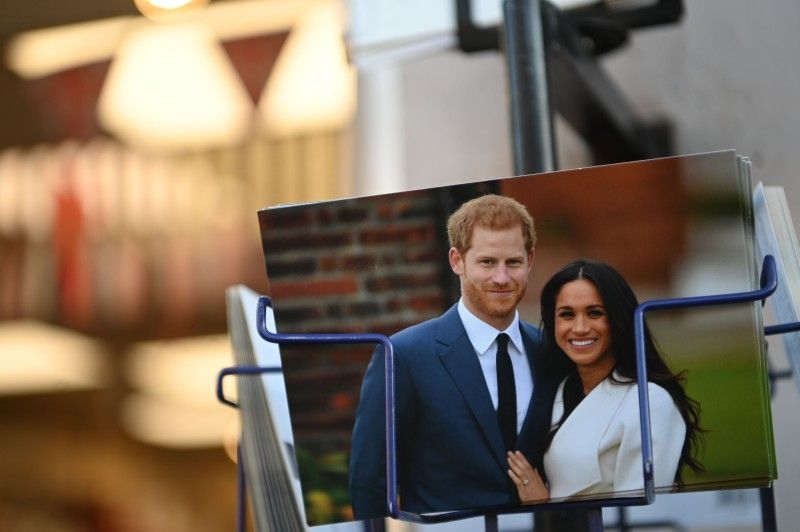 Royal memorabilia featuring Britain's Prince Harry, Duke of Sussex, and Meghan, Duchess of Sussex is displayed for sale in a store near Buckingham Palace in London on Saturday. Prince Harry's wife Meghan has returned to Canada following the couple's bombshell announcement that they were quitting their frontline royal duties. — AFP