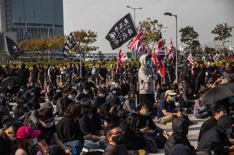 Pro-democracy protesters attend a rally at Edinburgh Place in the Central district of Hong Kong on Sunday. Hong Kong has been battered by protests for seven months, which from time to time fell into violent clashes between protesters and riot police. — AFP
