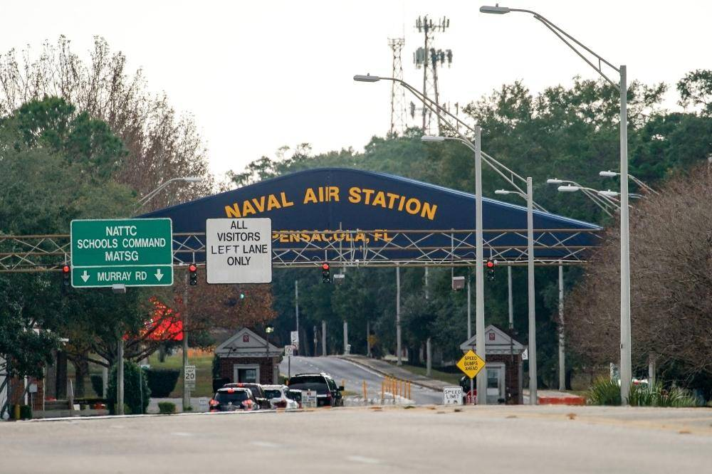 A general view of the atmosphere at the Pensacola Naval Air Station main gate following a shooting on Friday in Pensacola, Florida. The second shooting on a US Naval Base in a week has left three dead plus the suspect and seven people wounded. — AFP