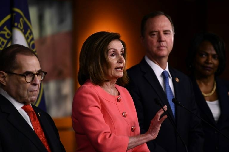Nancy Pelosi, center, has selected seven colleagues to help effectively litigate the impeachment case, including Jerrold Nadler, left, and Adam Schiff, right. — AFP