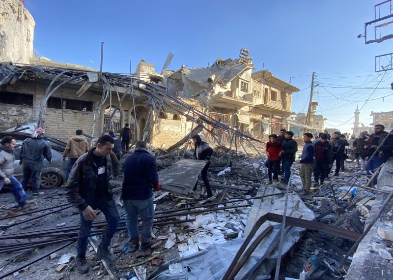Syrians gather amid the rubble following regime air strikes on a market in the town of Binnish in Syria's northwestern province of Idlib in this Jan. 11, 2020 file photo. — AFP