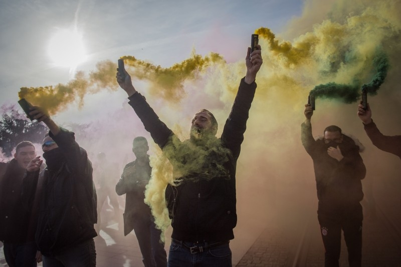 Demonstrators waves green and yellow flares during a protest called by the 'Yellow Vest' (gilets jaunes) anti-government movement as part of a nationwide multi-sector strike against the French government's pensions overhaul, in Nantes, western France, in this Jan. 11, 2020 file photo. — AFP