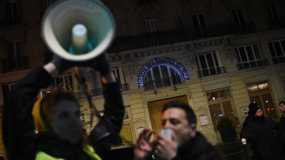 Macron rushed from Paris theater during protest