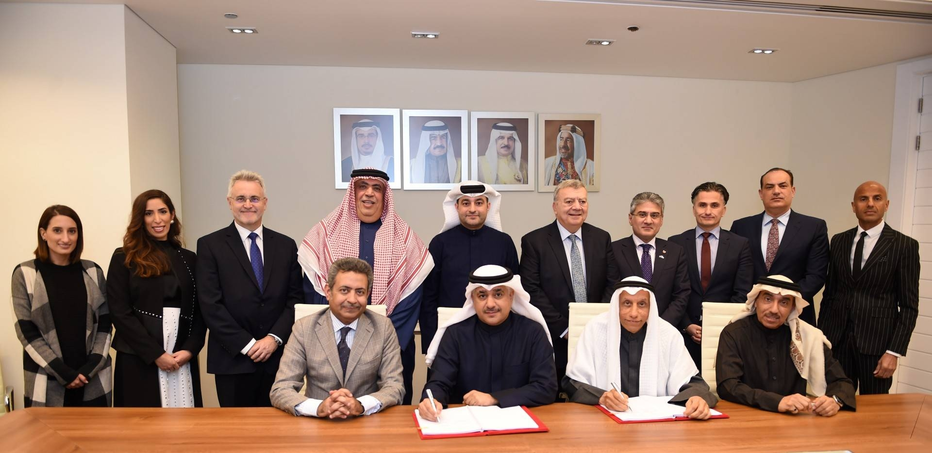 Officials of signatory companies pose for a group photo