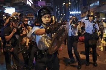 Hong Kong police at pro-democracy protests. -AFP