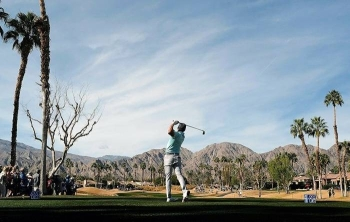 American Rickie Fowler on the way to a share of the second-round lead in the US PGA Tour event at La Quinta, California. — AFP