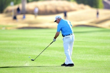 One-armed amateur golfer Laurent Hurtubise aced the 151-yard fourth hole at PGA West Stadium course in the first round of the US PGA American Express tournament. — AFP