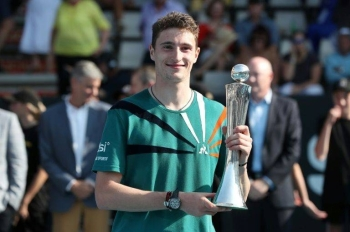 The unseeded Ugo Humbert held his nerve in the deciding tie-break of his first ATP final to win against Benoit Paire. — AFP