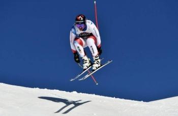 Switzerland's Beat Feuz jumps at the