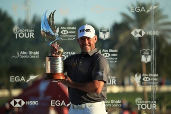 Lee Westwood of England poses with the trophy after winning the Abu Dhabi HSBC Championship following his final round on Day Four of the Abu Dhabi HSBC Championship at Abu Dhabi Golf Club on Sunday in Abu Dhabi. — AFP