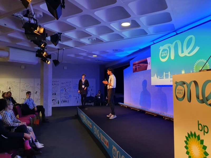 Zubair Junjunia on the Advancing Energy Stage for the Lightning Pitches at the One Young World Summit 2019, London.