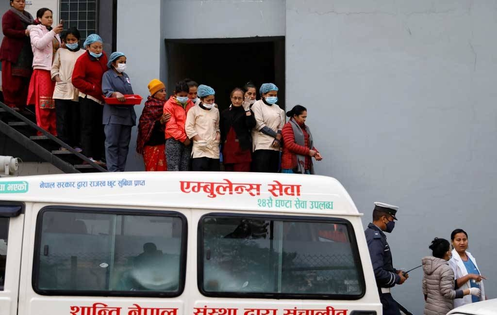 Hospital staff observe as the bodies of eight Indian tourists who died due to suspected suffocation are carried inside an ambulance while being taken for postmortem in Kathmandu, Nepal, on Wednesday. — Courtesy photo