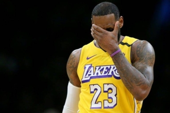 Los Angeles star LeBron James reacts during the Lakers' blowout NBA loss to the Boston Celtics. — AFP