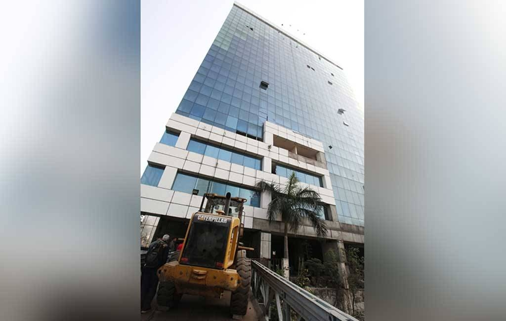 The demolition of the 15-story building in the capital Dhaka is set to be completed over six months using bulldozers as well as workers wielding hammers. — Courtesy photo