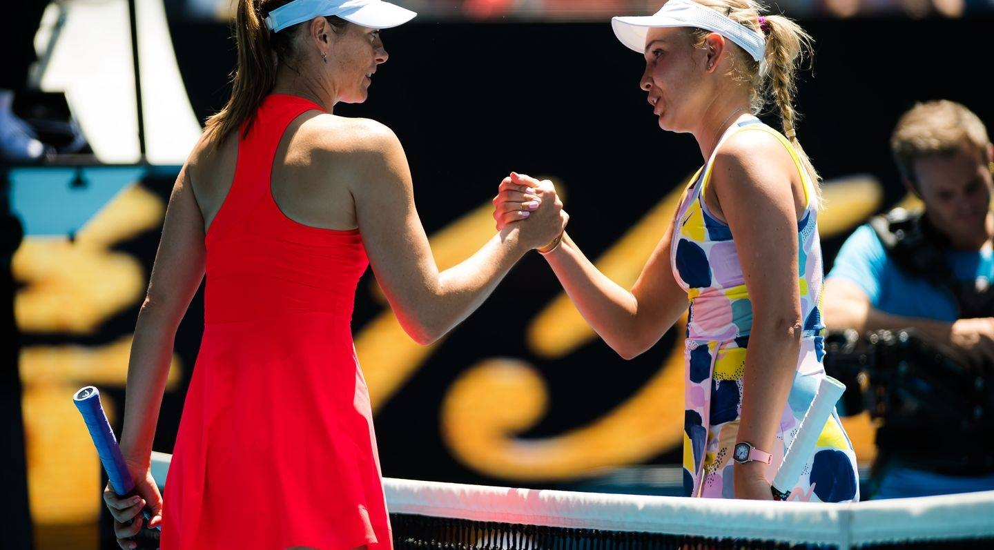 Maria Sharapova shakes hands with 19th seed Donna Vekic, right, following the straight-sets loss  in the Australian Ope in Melbourne.