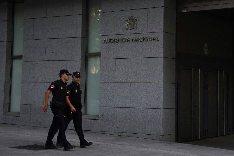 Spanish policemen walk in front of the National Court in Madrid. — AFP