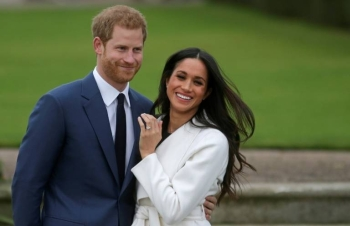 Prince Harry and his wife Meghan are seen in this file photo. — AFP
