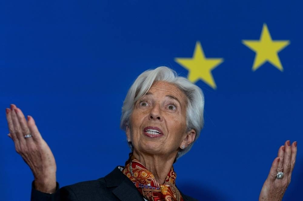 European Central Bank president Christine Lagarde was slightly more upbeat Thursday about risks to the eurozone economy, and insisted climate change would be central to a rethink of the institution's goals and methods.