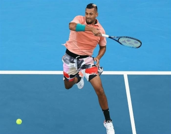 Nick Kyrgios reached the Australian Open third round on Thursday after the weather-disrupted tournament faced a new challenge: dirty rain which left courts muddy and unplayable.