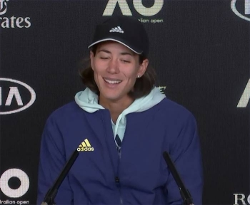 Two-time Grand Slam champion Garbine Muguruza climbed Mount Kilimanjaro to help clear her mind of tennis and the unusual off-season preparation is paying off after she reached round three at the Australian Open on Thursday. She is seen at the press conference after her win.