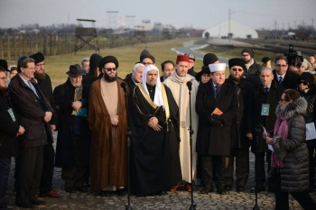Dr Mohammad Abdulkarim Al-Issa (C), secretary general of the Muslim World League (MWL) speaks at a candle-lighting ceremony at the memorial monument in the former German Nazi death camp Auschwitz-Birkenau on Thursday. — AFP