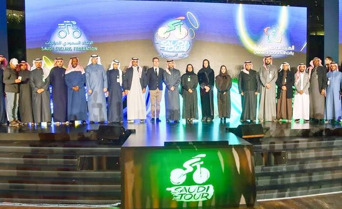 Members of the organizations set to conduct the Saudi Tour 2020 cycle race in Riyadh pose for a family photo at the press conference.