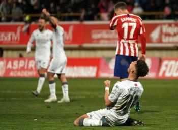 Cultural Leonesa defender Virgil Theresin celebrates his side's victory over Atletico. — AFP