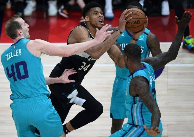 NBA Milwaukee Bucks forward Giannis Antetokounmpo drives toward the basket in the first ever NBA regular season game in Paris on Friday. — AFP