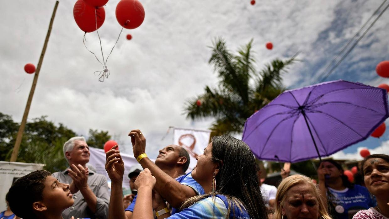 Mourners in Brumadinho, Brazil, released red balloons in memory of the 270 people killed following a massive dam breach on Saturday. — AFP