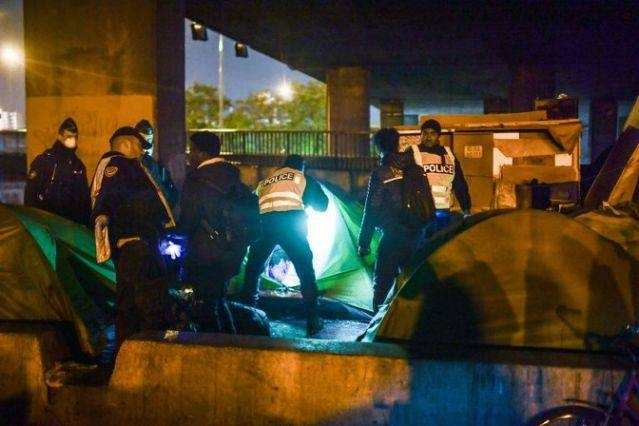 Police said 1,436 people — including 93 children and 1,187 single men — had been removed from the camp, where they had been living in tents and makeshift shelters along the Paris ring road. — AFP