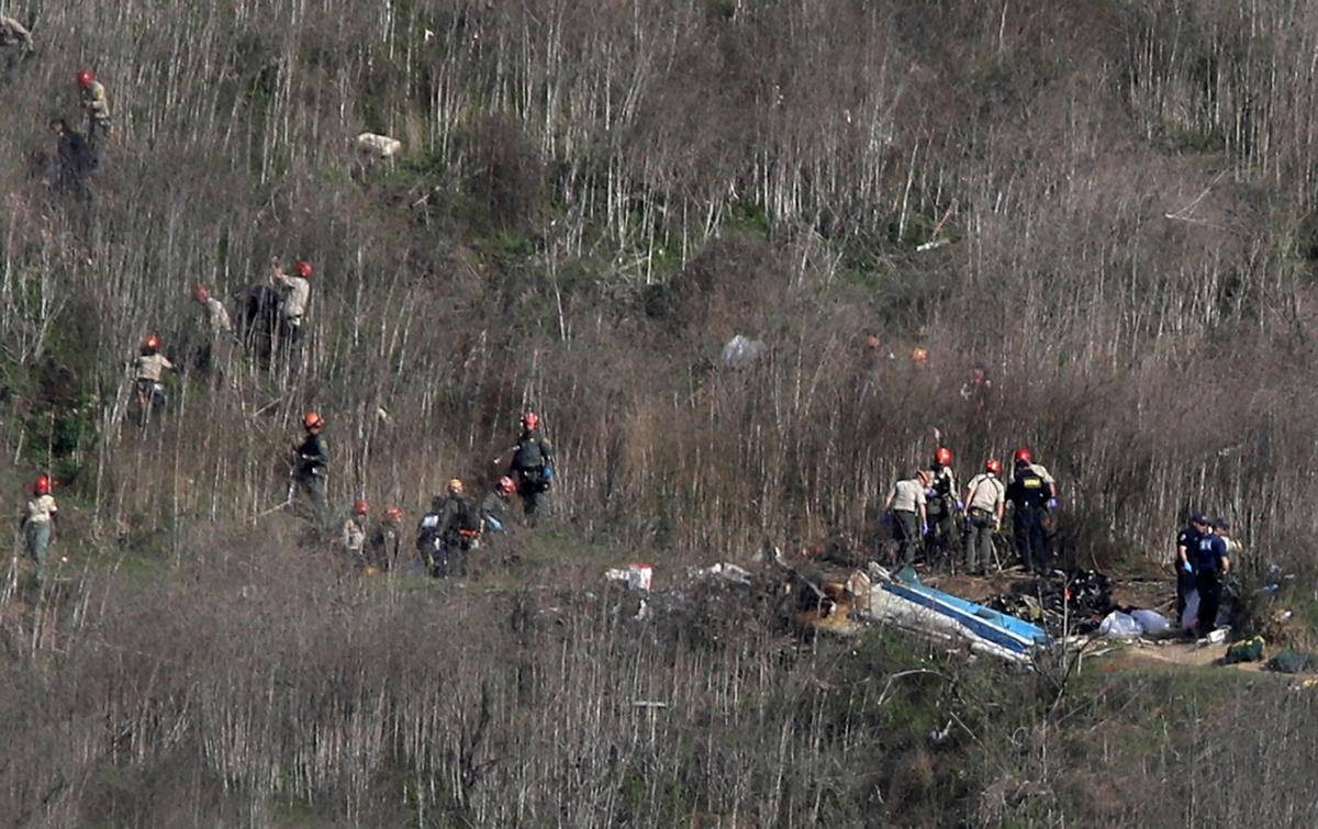 Emergency personnel work at the helicopter crash site that claimed the life of former NBA great Kobe Bryant in Calabasas, California. Bryant, 41, his daughter Gianna, 13, and seven others perished in the accident on Monday. — AFP