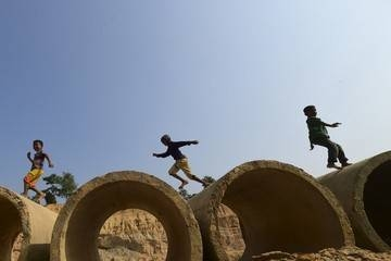 Rohingya children jump over on sewage concrete sections at Balukhali refugee camp in Ukhia, Bangladesh, in this Dec. 10, 2019 file photo. —AFP