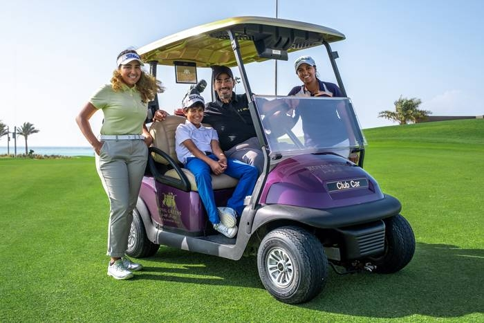 Layla and her family on the course at Royal Greens Golf & Country Club.
