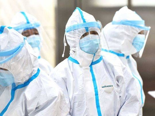 Medical staff members wearing protective clothing to help stop the spread of a deadly virus which began in the city, work at the Wuhan Red Cross Hospital in Wuhan. — AFP
