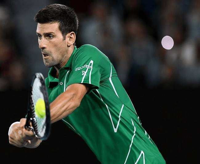 Novak Djokovic blunted Milos Raonic's razor serve to win 6-4, 6-3, 7-6 (7/1) and move two wins from an eighth Melbourne title.