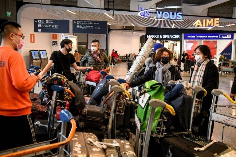 France has deployed a medical team to Paris's Charles de Gaulle airport to take charge of arrivals who showed symptoms of the contagious virus. — AFP