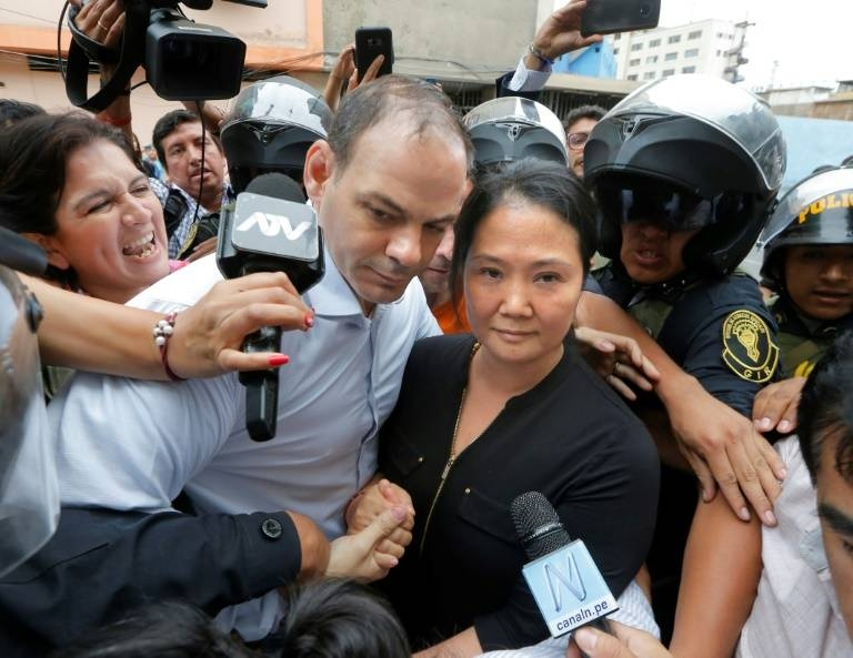 Keiko Fujimori arrives at a Lima courthouse with her husband Mark Villanella on Tuesday. — AFP