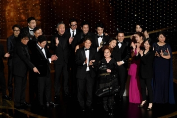 'Parasite' cast and crew including Cho Yeo-jeong, Park So-dam, Choi Woo-shik, Kang-Ho Song,Yang Jin-mo, Jin Won Han, Kwak Sin-ae, Ha-jun Lee, Yang-kwon Moon, Kang-ho Song, Yeo-jeong Jo, Bong Joon-ho, and Sun-kyun Lee accept the Best Picture award onstage during the 92nd Annual Academy Awards at Dolby Theatre in Hollywood, California, on Sunday. — AFP