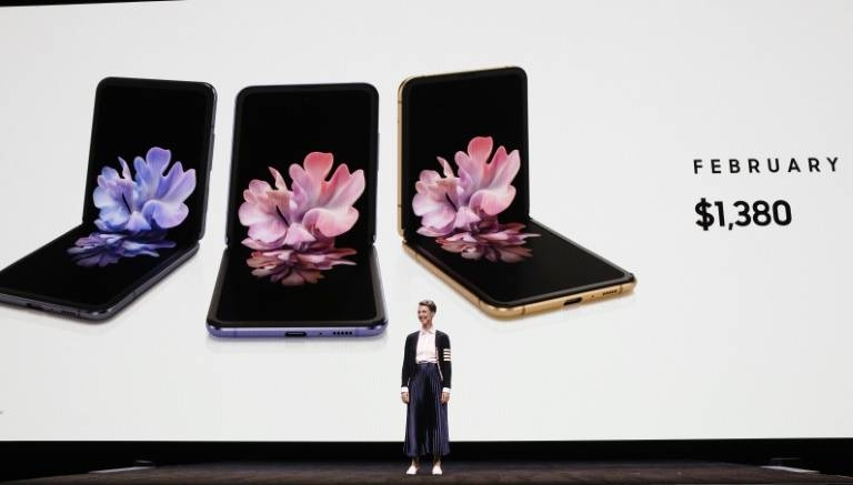 Rebecca Hirst, Samsung marketing director, unveils the Samsung's Galaxy Z Flip folding smartphone in San Francisco, California, on Tuesday. — AFP