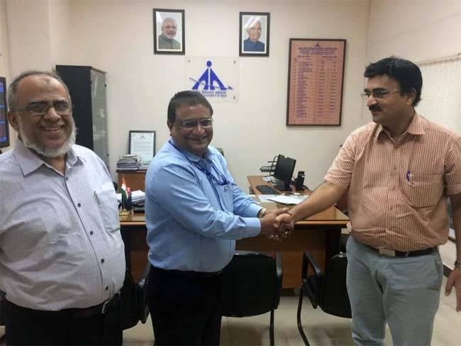 AI-K.M. Basheer meets with K. Srinivasa Rao, director of Calicut International Airport.
