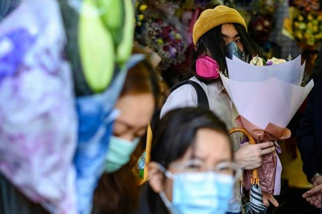 Flower sales have slumped in Hong Kong because of the virus outbreak. — AFP